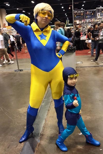 Carrie Cosson & daughter cosplay as Booster Gold and Blue Beetle