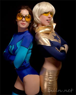 Katy Mor as Blue Beetle, Demyrie as Booster Gold by Bill Nash